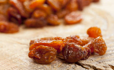 sultanas: Sultanas of wooden board (close-up)