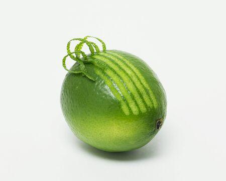 zest: A lime with curling zest LANG_EVOIMAGES