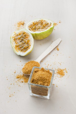 freeze dried: Passion fruit powder in a glass and on a spoon LANG_EVOIMAGES