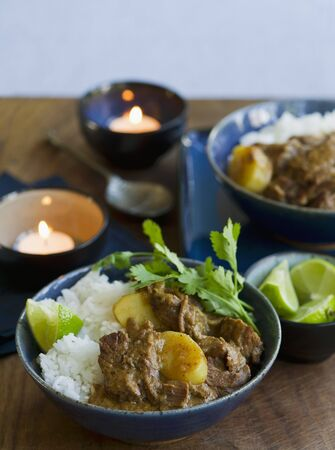 beef curry: Beef curry with rice and lemons