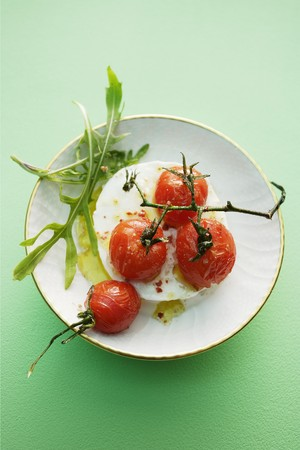 rimmed: Buffalo mozzarella with caramelised vine tomatoes LANG_EVOIMAGES