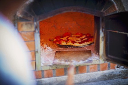woodfired: A freshly baked pizza in a wood-fired oven