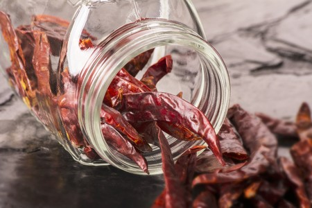 overturned: Dried chilli peppers spilling from an overturned storage jar