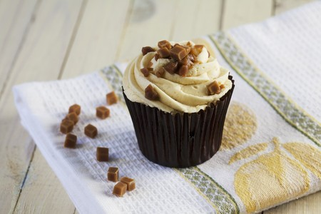 being the case: A caramel cupcake decorated with toffee pieces