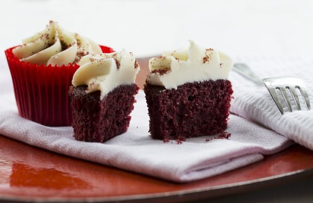 being the case: Red Velvet cupcakes topped with a light cream