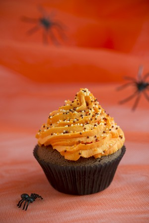 buttercream: A chocolate cupcake topped with orange buttercream for Halloween