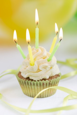 childs birthday party: Cupcake with birthday candles LANG_EVOIMAGES