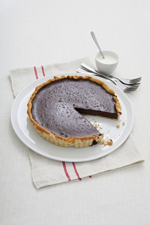chocolate tart: Sliced chocolate tart LANG_EVOIMAGES
