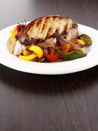 grilled pork chop: A grilled pork chop with roasted Mediterranean vegetables