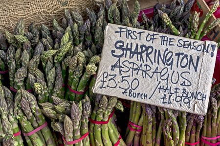 bunched: Fresh green asparagus on a market stall