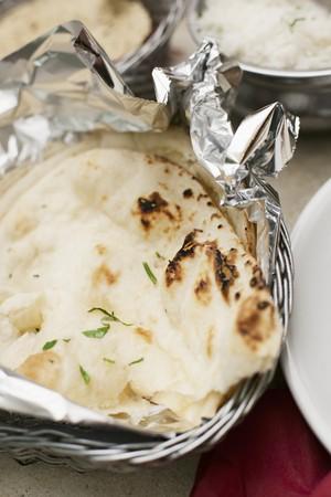 breadbasket: Naan bread in tin foil in a breadbasket LANG_EVOIMAGES