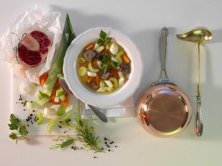 apium graveolens: Pot-au-feu with ingredients, a pot and a ladle