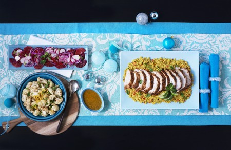 made in morocco: Maroccan roast turkey in slices on couscous with cauliflower and salad (viewed from above)