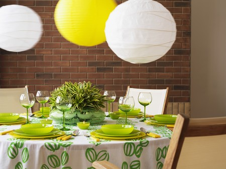 lampshades: A green and white table with paper lampshades
