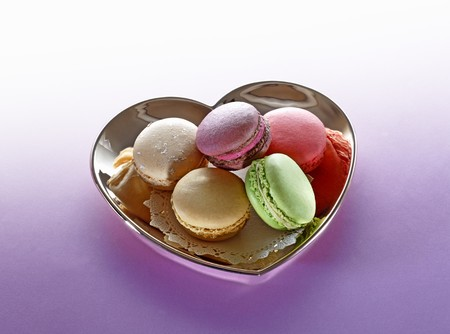 heartshaped: Different types of macaroons in a heart-shaped dish