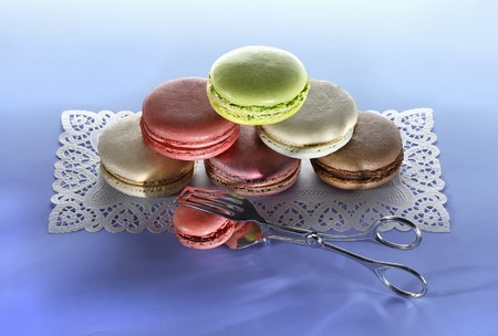 doiley: Different types of macaroons, stacked, on a cake paper placemat