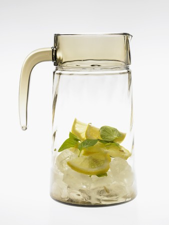 soda pops: Glass carafe with lemons, mint and ice cubes