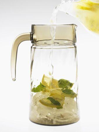 soda pops: Filling a carafe with essence of lemonade