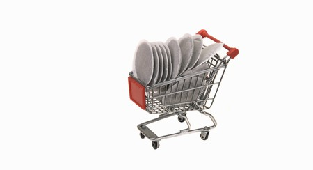 shopping trolley: A model shopping trolley filled with coffee pads