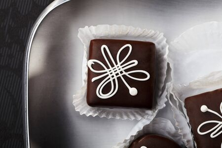 recipe decorated: Chocolate petit fours with white icing (seen from above)