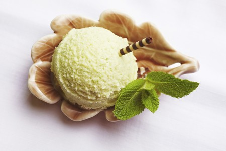 peppermint: A scoop of peppermint ice cream with fresh mint