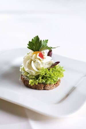 cream cheese: A canape with cream cheese and lettuce