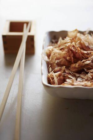 tunafish: Dried Japanese Bonito Flakes in Asian Bowl LANG_EVOIMAGES