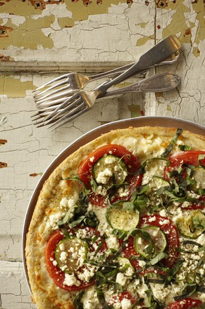 cocozelle: Thin Crust Pizza Topped with Zucchini, Tomatoes, Feta Cheese and Fresh Basil; From Above