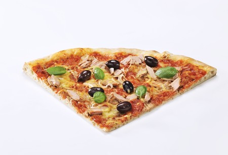 tunafish: A slice of pizza with tuna, olives and basil LANG_EVOIMAGES