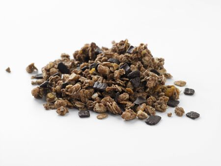 whiteness: Pile of Chocolate Muesli on a White Background