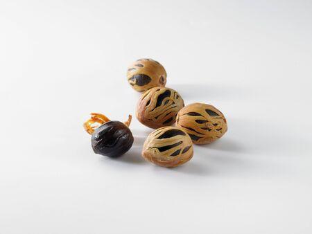 nutmeg: Whole Nutmeg on a White Background