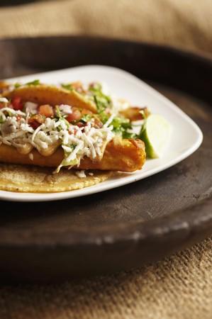 corn tortilla: Baja Taco; Fried Tilapia Taco in a Corn Tortilla with Slaw and Salsa