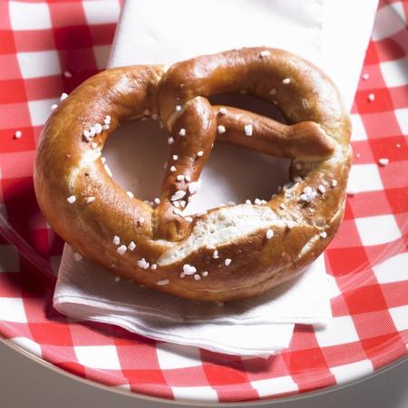 lye: Lye pretzel on a plaid plate