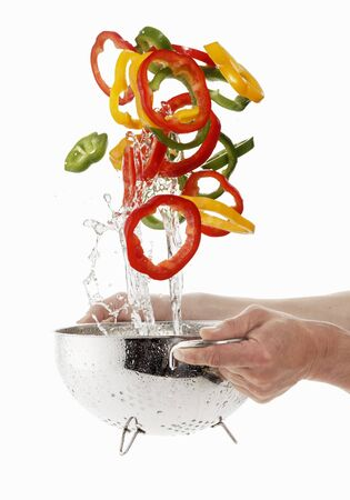 being: Pepper rings being washed