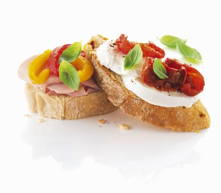 several breads: Slices of ciabatta bread with ham, pepper, mozzarella and tomatoes