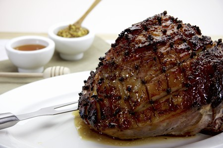ovenbaked: Glazed roast ham pierced with cloves