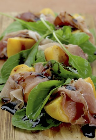 arugola: Peaches wrapped in prociutto with rocket and balsamic vinegar