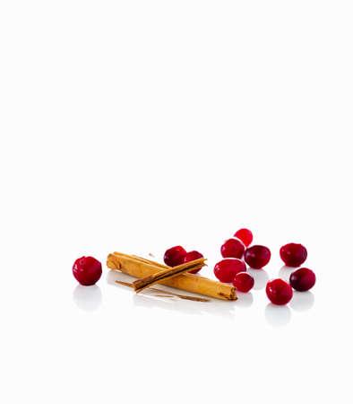 vaccinium macrocarpon: Cranberries and cinnamon sticks