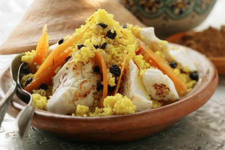 moroccan cuisine: Saffron couscous with fish, carrots and raisins (N. Africa) LANG_EVOIMAGES