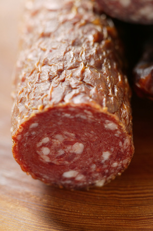 cut off: A venison sausage (salami), a piece cut off