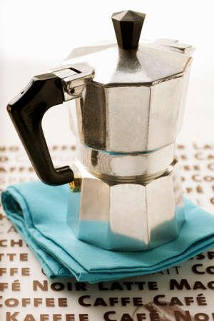 espresso machine: Espresso machine on blue napkin LANG_EVOIMAGES