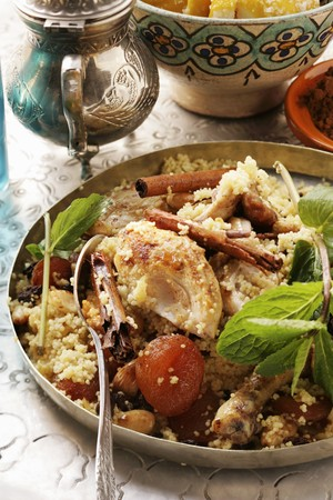 couscous: Couscous with chicken, dried fruit, almonds and cinnamon