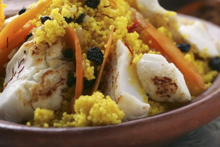 made in morocco: Saffron couscous with fish, carrots and raisins (N. Africa) LANG_EVOIMAGES