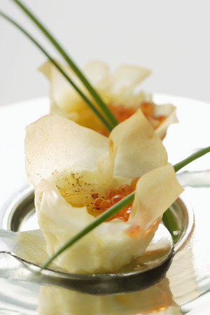 appetiser: Filled won tons with trout caviare and fried quail's egg