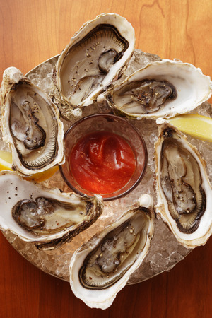 appetiser: Oysters with cocktail sauce on ice