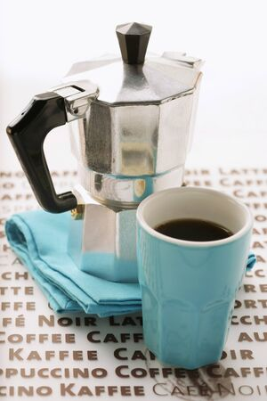 espresso machine: Blue espresso cup in front of espresso machine LANG_EVOIMAGES