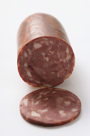 cut off: Spicy game sausage, a piece cut off
