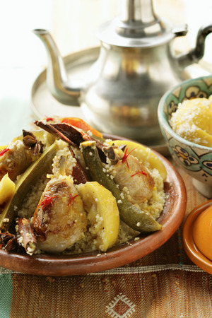 moroccan cuisine: Couscous with chicken, courgettes, tomatoes, lemons & cinnamon