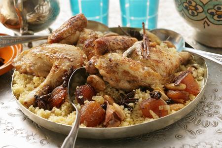 moroccan cuisine: Couscous with chicken, dried fruit, almonds and cinnamon
