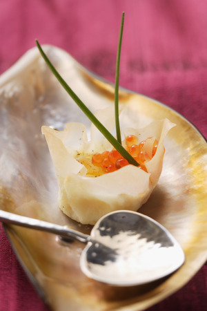 tons: Filled won tons with trout caviare and fried quail's egg